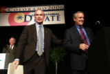 Before the start of the debate candidate Bob Beauprez (l) gives opponent Bill Ritter a pat on the...