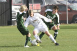 Mountain Vista's #9, left, Aaron Woodruff and #2, right, Josh Belfrage, try to defend against...