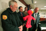 Jeffrey Sweetin (right) (cq) Special Agent in Charge, DEA, holds a Tickle-me-Elmo doll at the U.S....