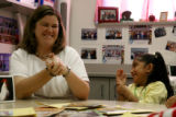 Denise Hitchcock, cq, laughs with one of her students, Estefania Osorio, 7,  during a Title 1...