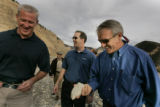 Bill Ritter holds up a piece of oil shale on a visit to  Encana a gas drilling operation in...