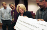 U.S. Representative Marilyn Musgrave, center, presents a ceremonial check for $246,807 to the...