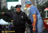 (NYT63) NEW YORK -- October 11, 2006 -- NY-CRASH-13 -- A police helps a medical professional get...