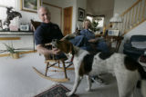 Bob Beauprez gives Petey (their sons dog) an under the chin scratch while sitting with Claudia in...