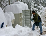 Evergreen mailman, Dao Truong (cq) delivers the mail to the Clear Creek mailbox station on Aspen...