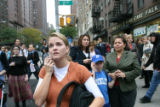(NYT50) NEW YORK -- Oct. 11, 2006 -- NY-CRASH-8 -- Pedestrians look up at an apartment building...