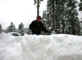 Keith Webb (cq) works on removing snow from his  driveway on Forest Estates Road Thursday morning...
