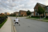13-year-old DeMarcus Richards (CQ)dribbles a basketball down Myrtle Street near his home late...