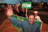 5:15PM - 7th congressional district candidate Rick O'Donnell (R) waves to drivers at the corner of...