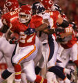 [JPM042] In the first quarter, Kansas City Chiefs running back Larry Johnson burst through the...