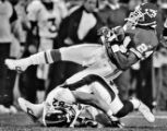 [ES108] - In the First quarter of play Denver Broncos tight end Stephen Alexander, bottom, falls...