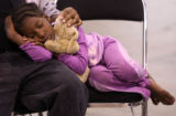 MJM058   C'ier Hamlet, 6, sleeps in the lap of her sister, Sydeny Hamlet (cq), 17, as she watches...