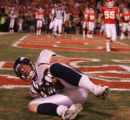 [JPM816] In the third quarter, Denver Broncos tight end Stephen Alexander (82) cradles the ball...