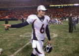 [ES108] - Denver Broncos back up rookie quarterback Jay Cutler walks off the field after the...