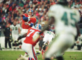 (DENVER, COLO., DECEMBER 3, 1995) Broncos quarterback John Elway throws the ball against the...