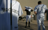 "Colorado Rockies infielder Clint Barmes, #12, left, gets dressed for ""Media Day"" during..."