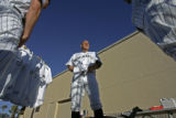 "Colorado Rockies infielder Clint Barmes, #12, center, gets dressed for ""Media Day""..."