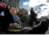 Thomas Wilkes, 3, listens to his dad, Nathan Wilkes (cq) speak  Monday February 26, 2007, to...