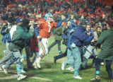 (DENVER, COLO., DECEMBER 12, 1993) Broncos quarterback John elway runs off the field with his...