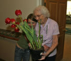 Olga Rice(cq), right, gives a hug to Amanda Cameron, after Cameron gave her a plant, Monday...