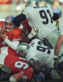 (DENVER, COLO., DECEMBER 15, 1996) John Elway inches for yardage on the goal line in the first...