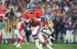 (DENVER, COLO., NOVEMBER 19, 1995) Quarterback John Elway runs back to pass during the November...