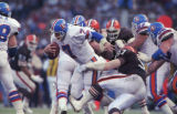 (DENVER, COLO., DECEMBER 8, 1991) Denver quarterback John Elway fights for more yardage against...
