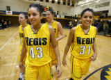Regis University's Denise (#43) and Diana Lopez (#31), twin sisters from Ranum High School, are...