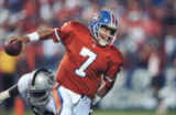 (DENVER, COLO. SEPTEMBER 6, 1992) John Elway scrambles and breaks away from the rush by a L.A....