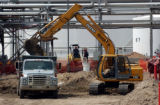 (COMMERCE CITY, CO.,  Aug 2, 2004) A earth mover fills the back of a dump truck at Suncor Energy -...