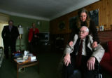 Courtney Dodd (cq), 23 helps her grandfather Robert Keeler (cq) with his jacket at his home in...