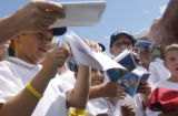 (CASTLE PINES, Colorado. August 02, 2004) Kids line up to get an autograph from British Open...