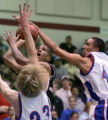 Cherry Creek's #23 Grant Parker and #44 Taylor Montgomery block a shot by Palmer's #24 Jo Jo...