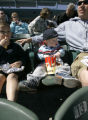 Damon Schndler, from father, 20 months old, of Tucson, attends his first baseball game with his...