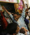 Student Naomi Tate celebrates when she hears that the students will be getting books on their wish...