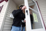 Adan Heter (cq) left, and his father  Phil Heter (cq) inspect and photograph a foreclosed home at...