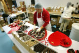 Stephany's Chocolates employee Fabiola Martinez (cq, center) of Denver assembles a heart-shaped...
