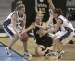 Arapahoe's Amy Barczuk, middle black, looses the ball to Dakota Ridge defenders Brooke...