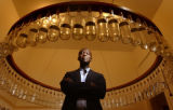 (Denver, Colo., May 12, 2004) Portrait of British architect David Adjaye next to a work by Paul...