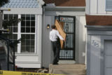 A CBI agent brings in some boxes at 705 Brome Pl in Lafayette Thursday morning March 1, 2007.  A ...