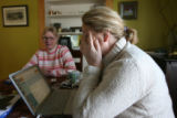 Eileen Dunne, (cq), left, sits with her daughter Jennifer Prantl, (cq), right in Prantl's home,...