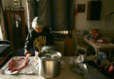 Marie Etsitty (cq) cleans mutton fot stew at the Ute Mountain Ute Tribe Reservation in Towaoc,...
