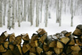 Piles of chopped firewood sit stacked on the porch of the Sundown cabin on the 1,500 acre Home...