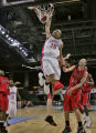 Denver East's Jordan Martinez-Doublin dunks in two of his total 12 points in the third quarter of...