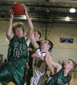 (from left) D'Evelyn's Jake Lidvall wins the ball for the Jaguars, as Steamboat's Colby Kostur is...