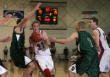 (from left) D'Evelyn's Tommy Lepke tries to block Steamboat's Aaron Calkins, as Joshua Gesell and...