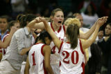 DLM0453  Regis forward Diana Rolniak screams as she celebrates with teammates Mariah Williams,...