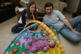 Julia and Dan Singleton, (cq), with their 3 week old daughter Daphne, (mom), have fun in the...