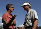 (BOULDER, CO. - AUGUST 17, 2004)  Jeremy Bloom's father, Larry Bloom, left, and  CU football coach...