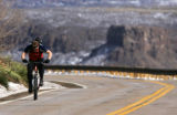 Alan Tiefenbach (cq), of Littleton, battles a head-wind while riding up Lookout Mountain in...